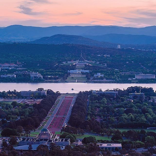 "With the sun about to set for another day we thought we'd share another beautiful sunset view of the city, this one by Instagrammer @imagjen_. The photo is rather appropriately called ""Epic Views ft Parliament House"". Where would you recommend visitors go for the best views over Canberra? #visitcanberra #onegoodthingafteranother"