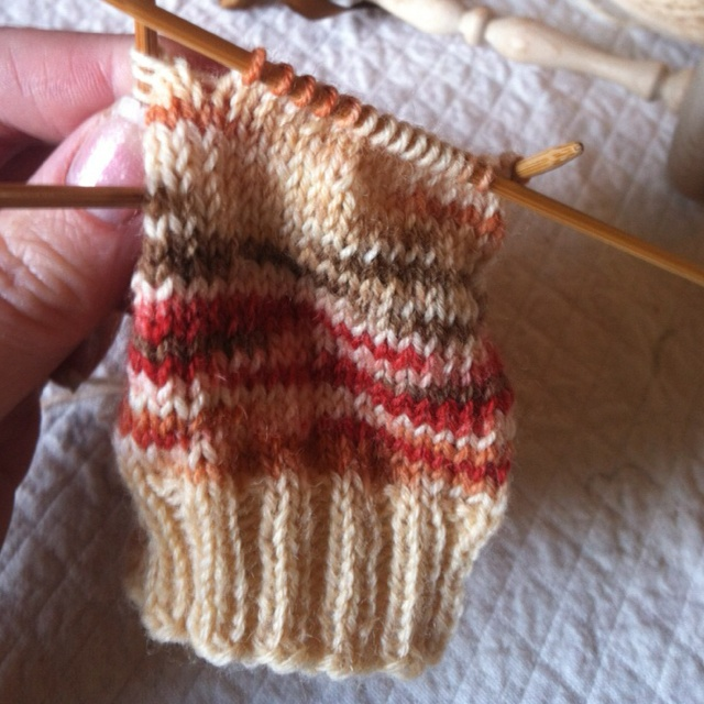 Sock knitting on double pointed needles with wool yarn. Total bliss!