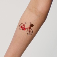 Katie Evans has a monopoly on cute bikes at Tattly. Don't let the adorable basket fool you, the wearer of this Tattly is sure to pop a mean wheelie once in a while.