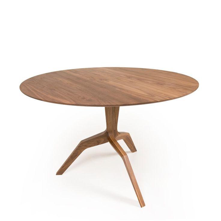 """Mars Round Table is ontworpen door Matthew Hilton. Hij heeft aparte poten die aan het wagentje op mars doen denken. De tafel is helemaal gemaakt van hout dit zorgt voor een mooi stuk. Te krijgen in verschillende soorten hout. Dia 43.3"""" x H 28.75"""" prijs: 3795,-"""