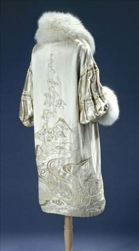 "Evening Coat, Eugénie and Juliette: ca. 1925, metallic and sequin embroidered silk satin, canvas lining, fox fur collar and cuffs.    Label/Imprint: ""MODELE DEPOSE / Eugénie et Juliette / 20. RUE DES CAPUCINES. PARIS"""