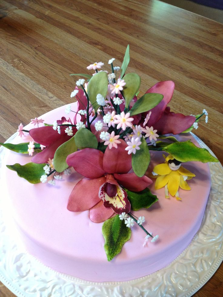 Orchids and a fairy cake for fun