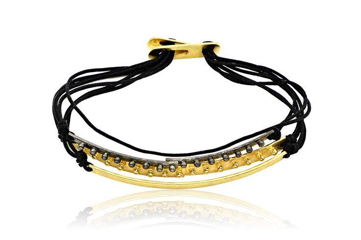 Βραχιόλι με κορδόνια και μοτίφ από επιχρυσωμένο και οξειδωμένο ασήμι 925.  Bracelet with cords and motifs made by yellow gold-plated and oxidized silver 925. Price:110€