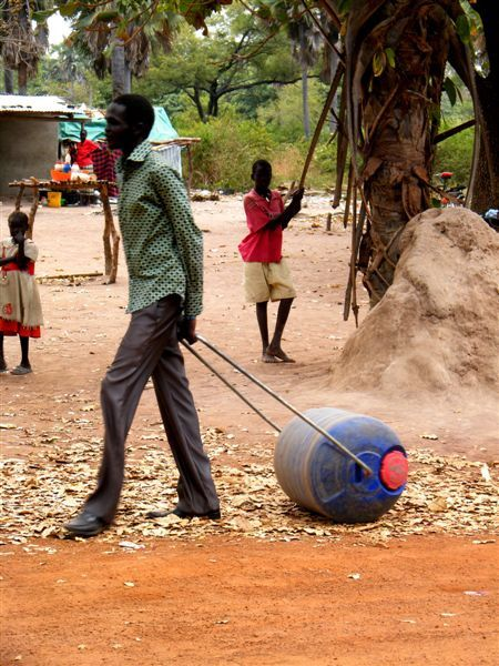 Sudanese man pulls a Hippo Water Roller.