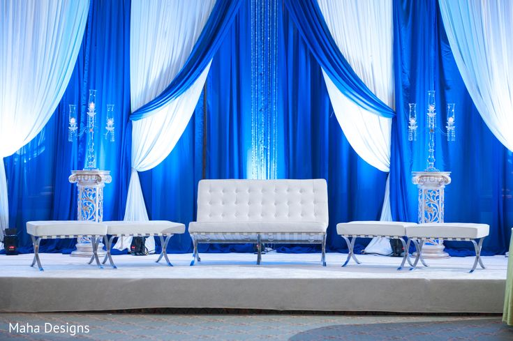 This beautiful Indian wedding reception features blue floral and decor.
