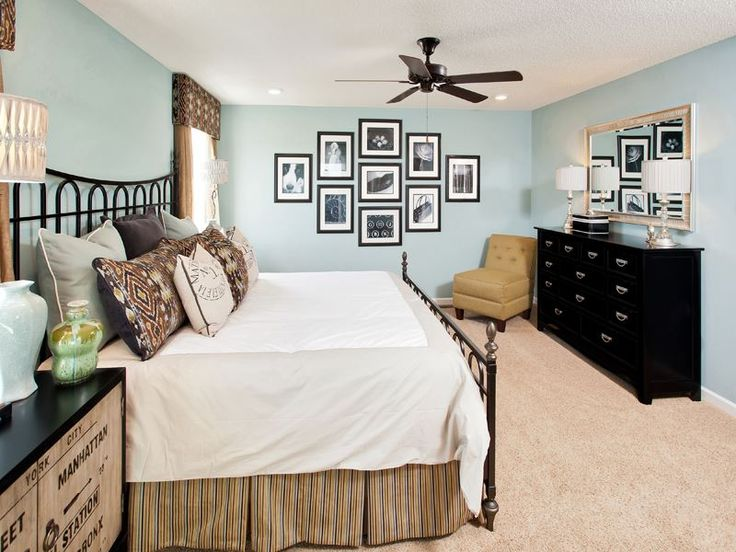 Pictures on wall & mirror above dresser