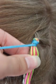 Colorful Hair Wraps in my sisters hair. using string or yarn.braiding though the hair.
