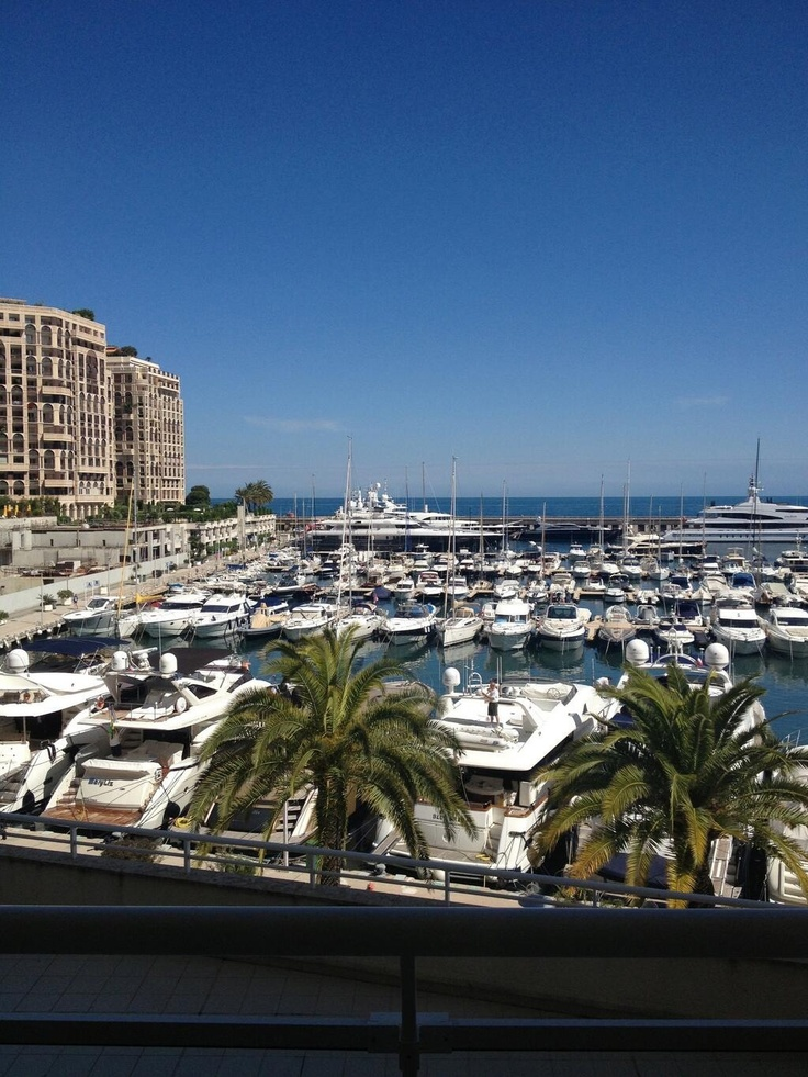 Monaco's Yacht Harbor. The yacht club is the symbolic centerpiece of the Monaco's remodeled harbor front. It celebrates the principality's spectacular coastline and its nautical heritage.