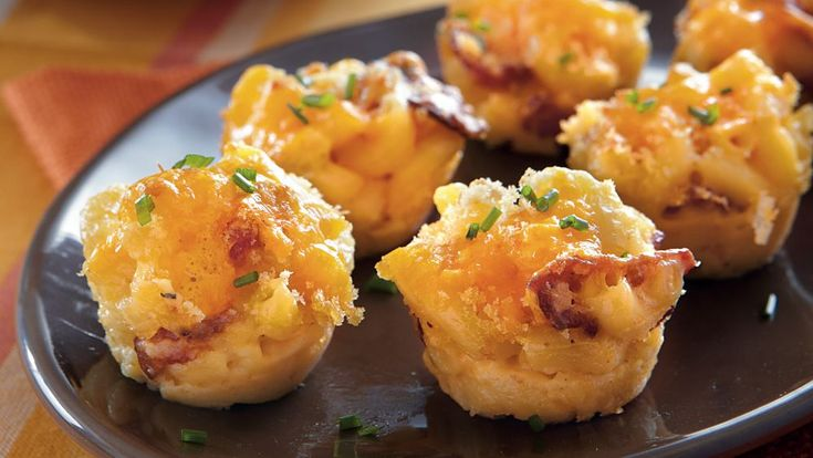 Welcome your guests by serving these cheesy baked bites made using bacon and macaroni. Perfect appetizer for Halloween.