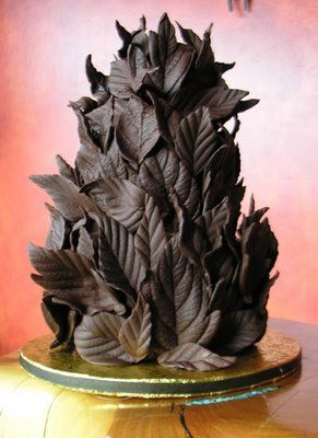 Yes, it's a cake. Three tiers of scrumptious dark chocolate cake covered with delectable hand-made dark chocolate leaves