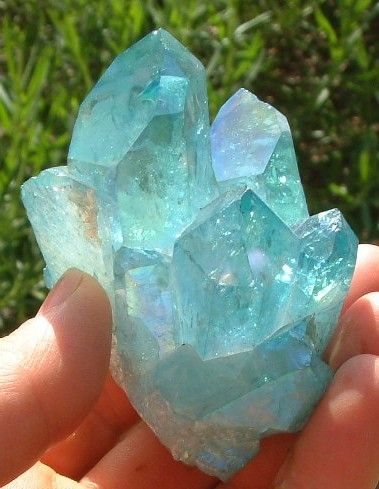Aqua aura quartz cluster.