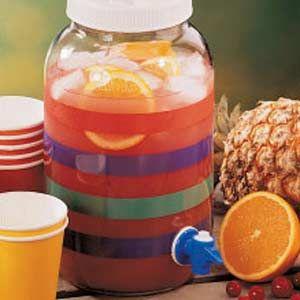 8 cups cranberry juice  3 cups pineapple juice  3 cups orange juice  1/4 cup lemon juice  1 liter ginger ale, chilled  1 medium navel orange, sliced