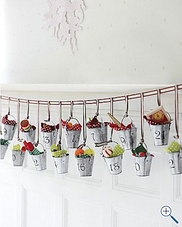 Buckets of Joy Advent Calendar: 25 tiny galvanized steel buckets on a twill cord. Each numbered basket is lined with a removable cotton fabric to conceal a small gift. On sale $24.
