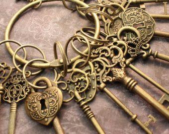 12 Large Skeleton Keys and 4 Lock On A Big Ring Antique Brass