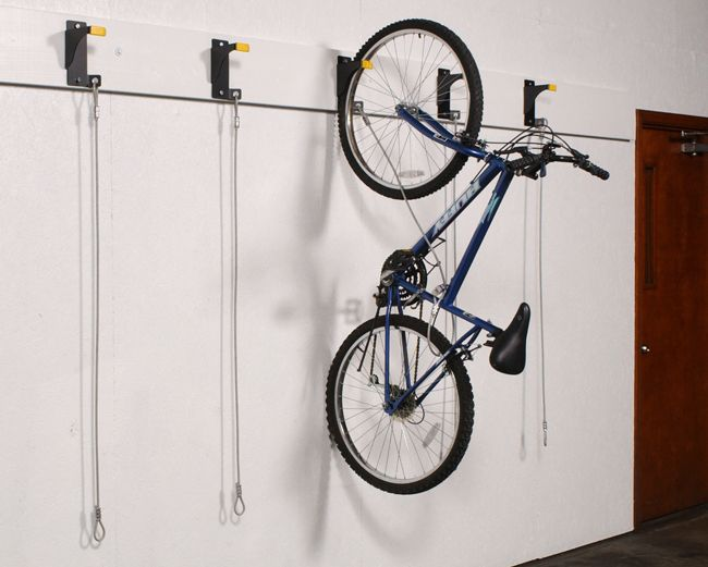 Multiple Bike Storage   WireCrafters - Bicycle Wall Riders can be mounted around a room continuously to store multiple bikes.