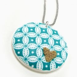 Mod Podge pendant decorated with fabric and microbeads