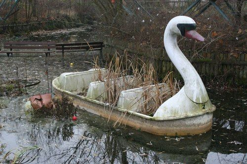 Overgrown swan ride at the abandoned Spreepark in Berlin