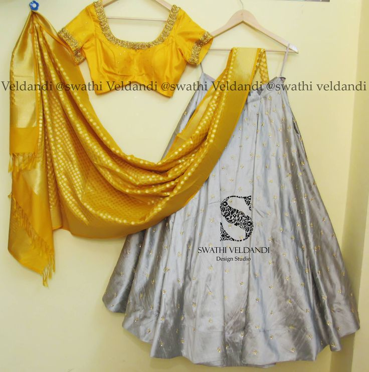 Lehenga in soft yellow and grey color with beautiful yellow pattu dupatta.<br>Blouse in yellow with gold embroidery on neckline and sleeves. 22 December 2017