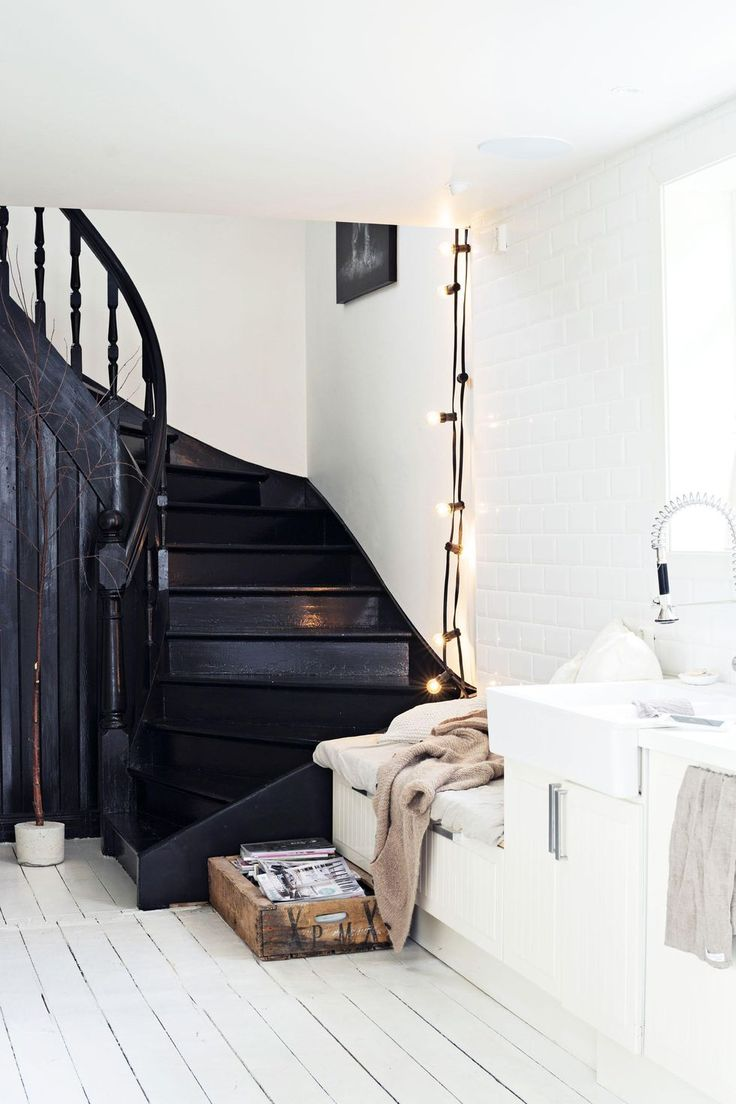 wondrous dark stairs and white walls