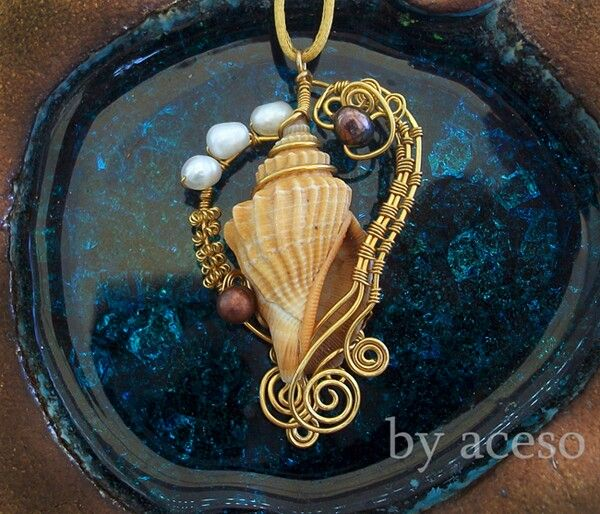 .wrapped sea shell pendant