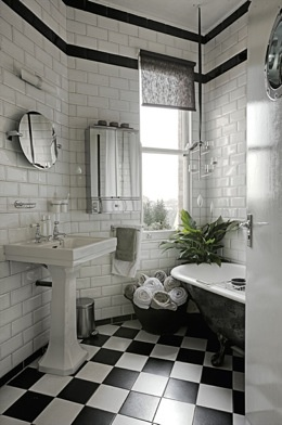 soften up checkered bathroom with greenery