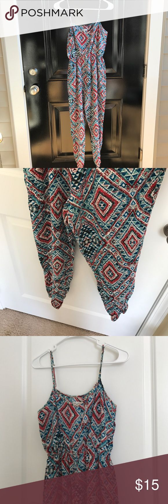 NWOT Charlotte Russe Tribal Print Jumpsuit NWOT Charlotte Russe Tribal Print Jumpsuit..size M.. has adjustable straps..measurements laying flat: size 15 inches, waist 11 inches (elastic), length from top of strap 49 inches (can vary due to adjustable straps), and inseam 25 inches Charlotte Russe Pants Jumpsuits & Rompers