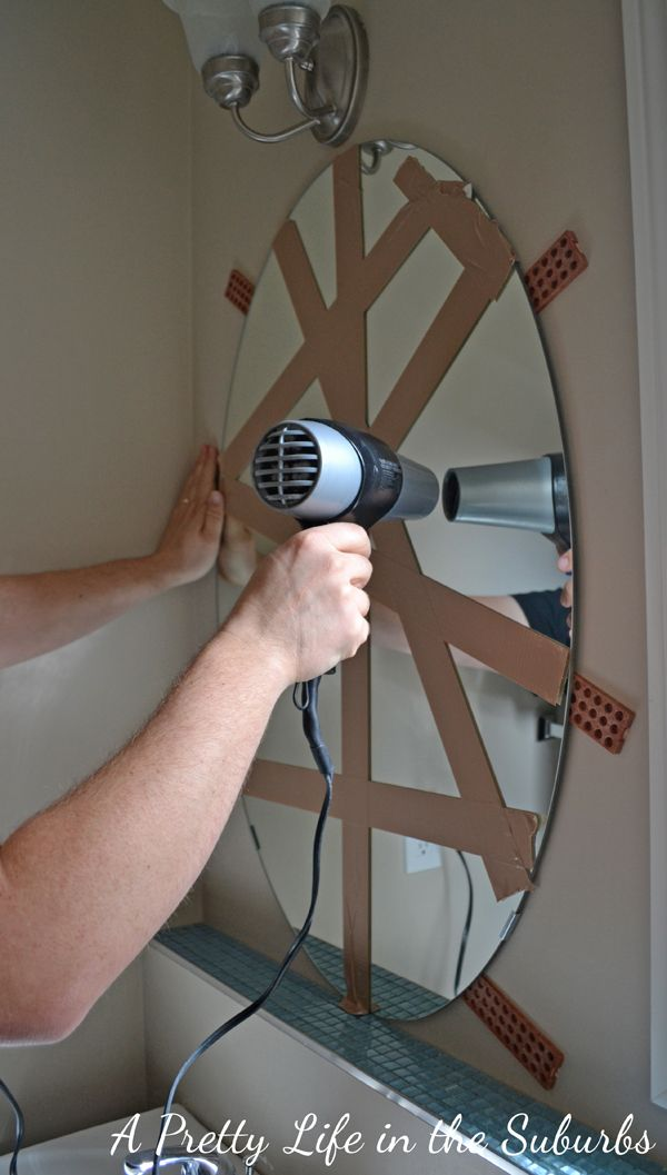 How to get a builder mirror off the wall with no holes!
