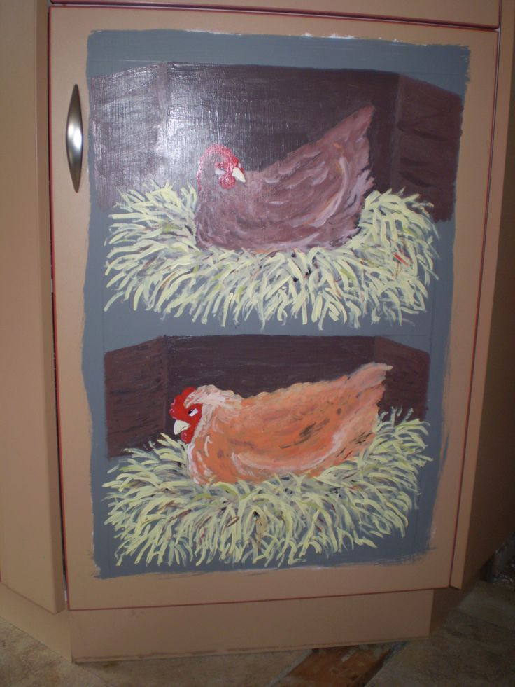 Painted out more peach coloured cabinets with chickens. Still will have more done to it to make them look more like nesting boxes.