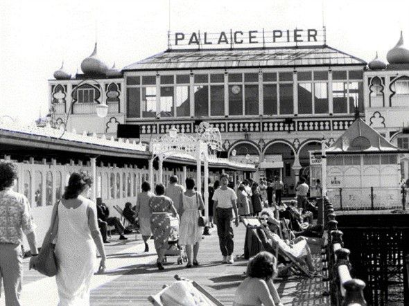Palace Pier, Brighton in the 1980s (the owners changed the sign to Brighton Pier in 2000, an informal name change not recognised by the National Piers Society or many Brightonians). The full name of the pier is 'Brighton Marine and Palace Pier'