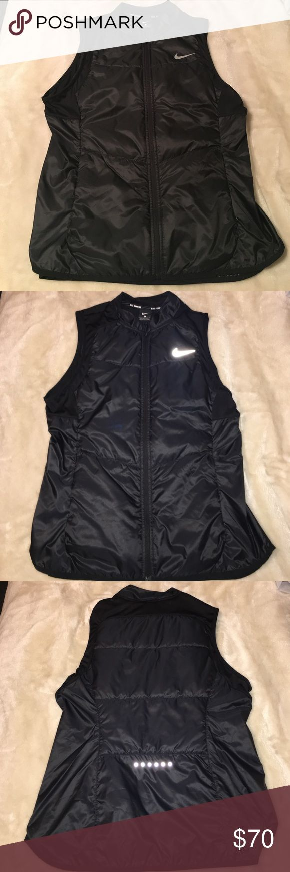 NWT Black Light Weight Nike Vest NWT, got as a gift but never wore it, black with reflective material for running in the dark at night, water proof, super light weight and comfortable!! Nike Jackets & Coats Vests