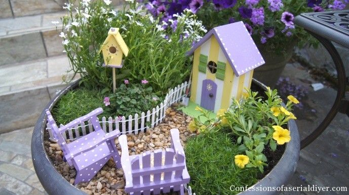 Fairy Garden, inspiring. I love the way the white picket fence is holding in the taller greenery. Love the popsicle stick door and adirondack chairs too.