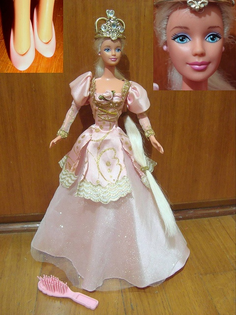 I HAD THIS BARBIE! OH MY GOSH! (Except her hair got sooooo knotted that I had to cut it. In that sense, my barbie was very true to Tangled. hahahaha)