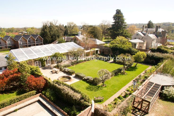 High level rear view of Northbrook Park, showing the walled garden and Orangery, and the back of the Vine Room. Courtesy of workspacephotography.co.uk