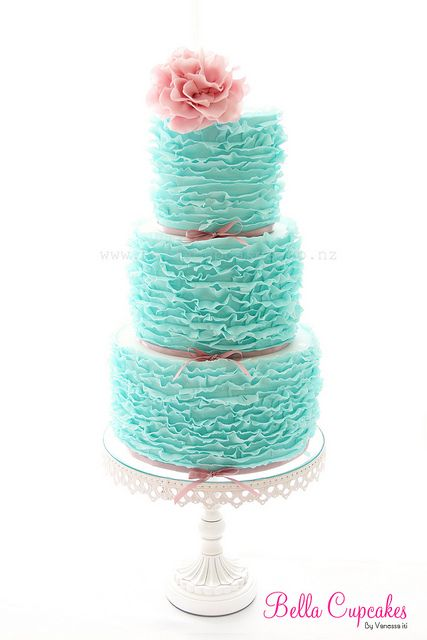 Tiffany Blue Ruffled Wedding Cake topped with a Pink Flower