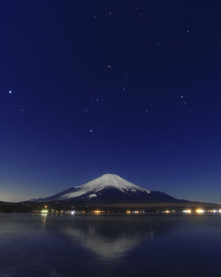 Orion and Fuji-san. Yowatashi Boshi = passing the night stars. Rigel is sometimes called Genji Boshi, and Betelgeuse, the Heike Boshi. These titles refer to the legendary war that brought and end to the Heian era between the Taira (Heike) and Minamoto (Genji) families. The colors of Taira were red (Betelguese), and the colors of the Minamoto family were white (Rigel).