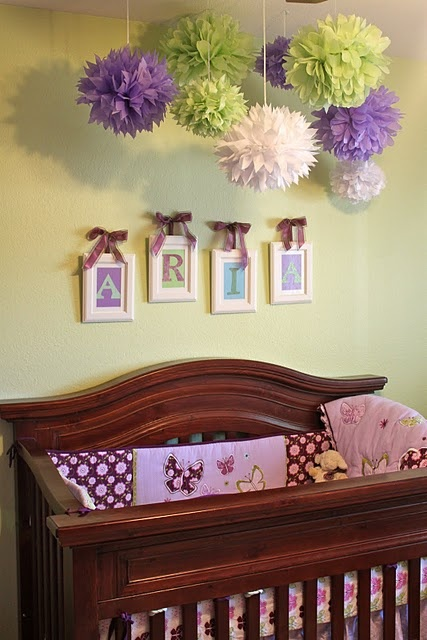 This is adorable, love the how the name is in each frame and love the paper flowers above the crib. This would be cute idea for any age child. Found it over at Serenity Now.