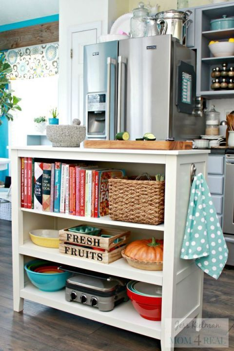 From the front, this piece looks like your average island — but from the back it's storage central for everything you want (cookbooks, holiday accessories), but never seem to have enough space for.  See more at Mom 4 Real »