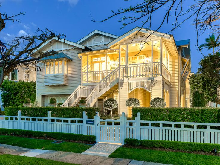 Queenslander house in Ascot - gorgeous. Love the front fence and hedges.