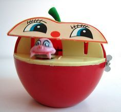 1970's toys - The Apple and Worm mechanical bank---we all loved putting money in this bank!!!