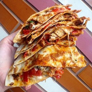 Grilled Chicken Stacked 4-Cheese Quesadilla with Signature House Salsa and Sauce!