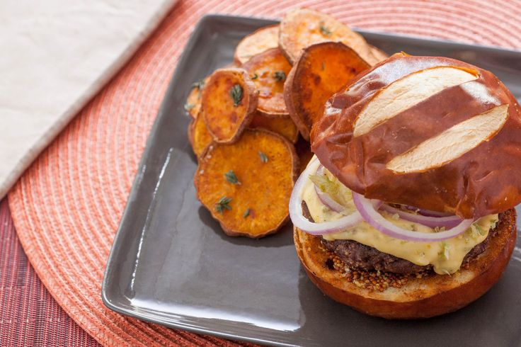 Pretzel Burgers with Hoppy Cheddar Sauce & Roasted Sweet Potato Rounds //both the sweet potatoes and cheddar sauce look good