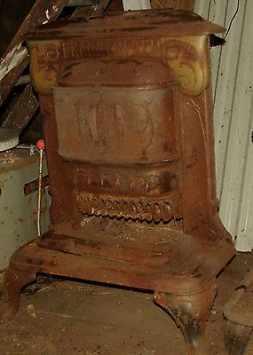 Antique Franklin Gem parlor stove, cast iron, for someone who needs warming