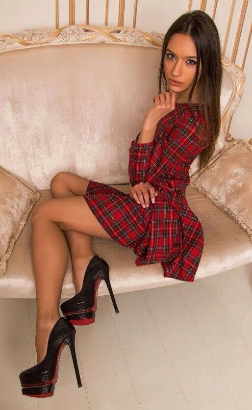 Slim crossdresser looks great in tartan dress.