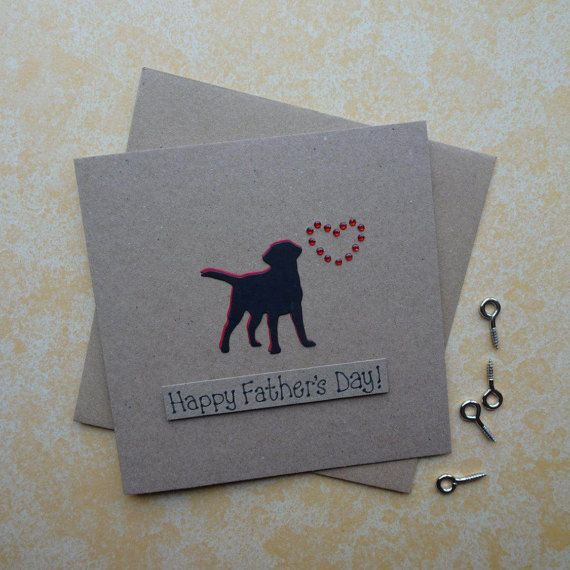 Happy Fathers Day dog card. Labrador Fathers Day card: dogs silhouette and heart of red gems. This Black Labrador handmade card for Dad would also make a great Anniversary or Birthday card.  The card has a the silhouette of a Black Labrador (Black Lab) standing happily with their tail in the air. The shadow of the dog is red card and there are red round gems in the shape of a heart just above the dog. The sentiment is added with 3D foam and reads: I Labr-adore you  PERSONALISING YOUR CARD…