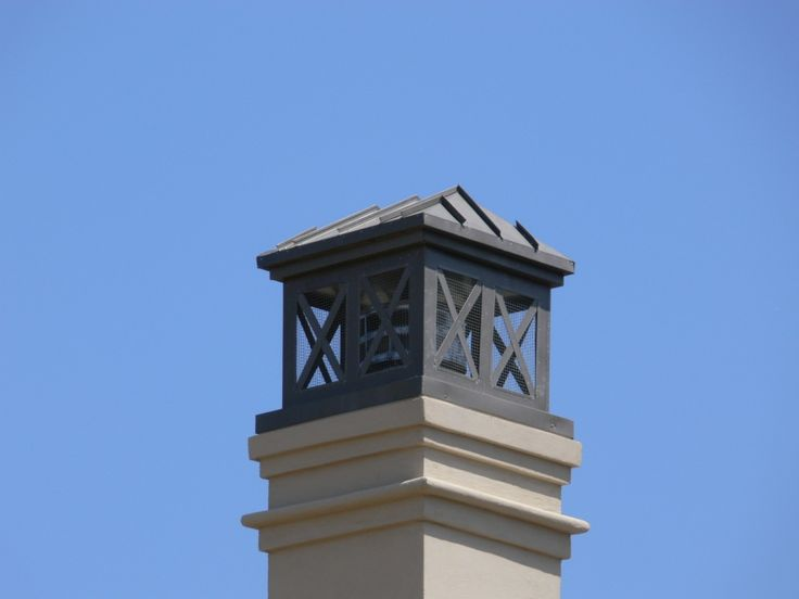Copper chimney cap reflective of old farmhouse charm