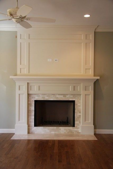 warm color scheme for living room: off white trim and cream tile around fireplace (eat sleep decorate)