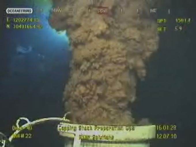 An image from a BP video on July 12, 2010, shows oil flowing from the top of a transition spool at the Deepwater Horizon drill site.