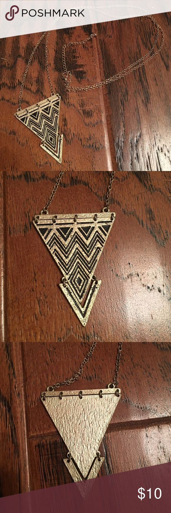 Chevron necklace Trendy gold and black chevron long necklace. Great with plain tops to jazz up any outfit. Jewelry Necklaces