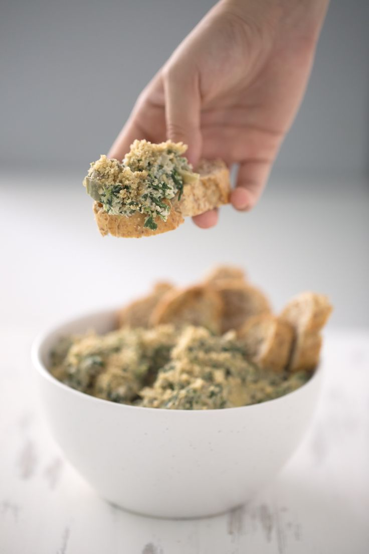 Vegan Spinach & Artichoke Dip.- This vegan spinach & artichoke dip is low in fat, so easy to make and ready in just 30 minutes. It's the perfect appetizer or snack!