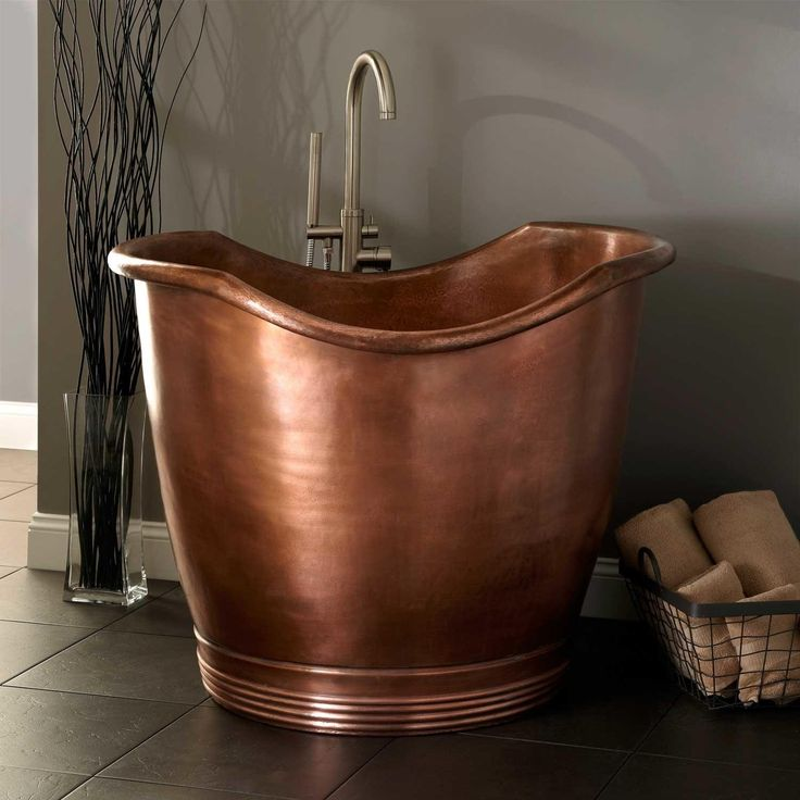 An antique copper exterior and miniature size make this tub a true standout. $3,541; signaturehardware.com   - ELLEDecor.com